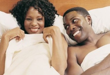 black-couple-happy-in-bed