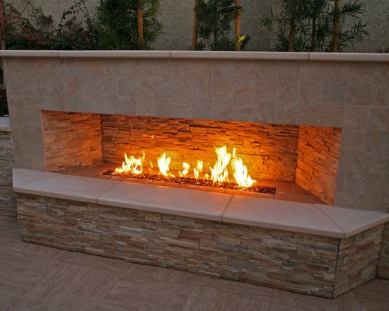 Warming Up The Backyard Patio By Outdoor Fireplace