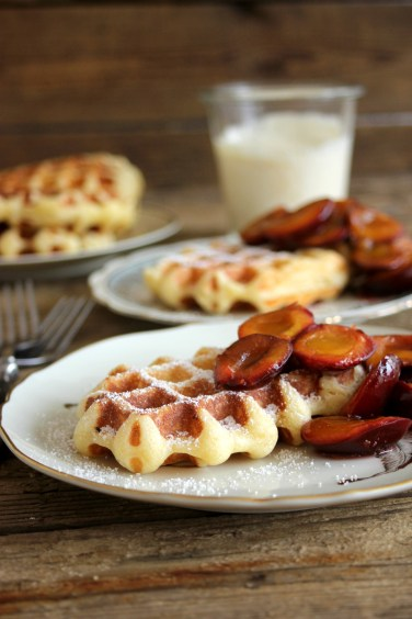 Waffles with plums and sweet cream