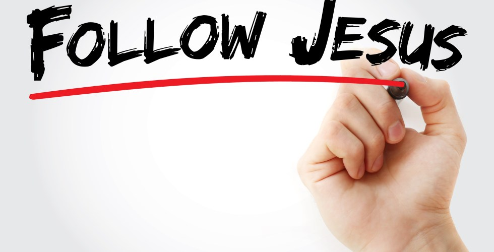Hand writing Follow Jesus with marker, concept background