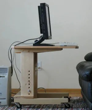 Side of adjustable desk