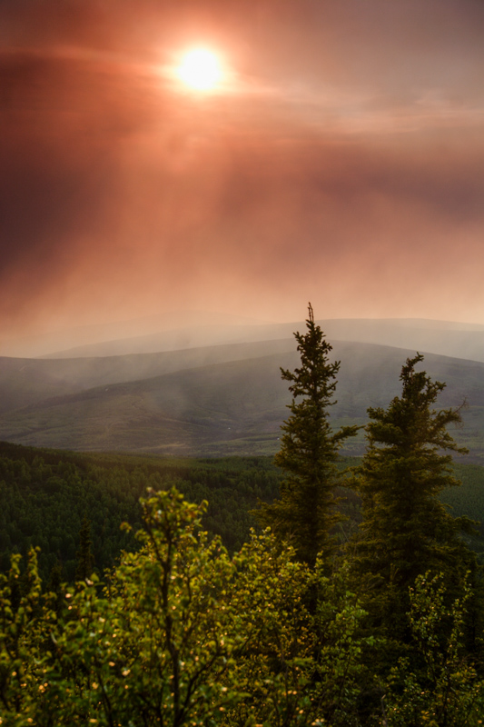 Forest fire smoke blows over the boreal forest of interior Alaska.