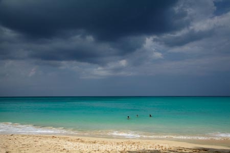 Dark Theme Wallpaper Hd Quote People Swimming At Waimanalo Beach And Storm Clouds Oahu