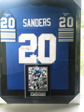 PRICELESS - This autographed and framed authentic Barry Sanders jersey was donated by Banyan Sober Living of Michigan