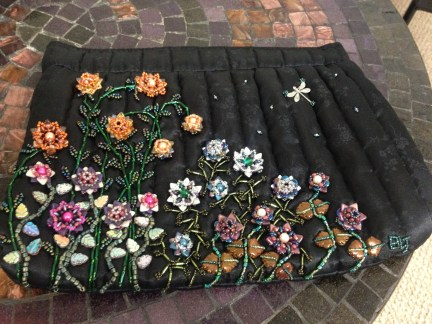 $500 VALUE - Black clutch with hand-beaded flowers and decoration by Strings of Bling