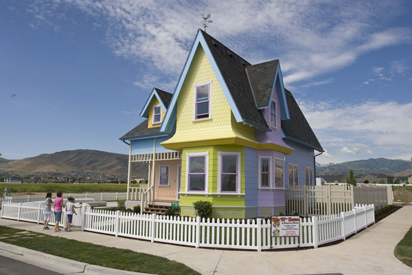 "In this July 6, 2011 photo, a full scale rendition of the house in the animated movie, ""Up,"" located a  in Herriman, Utah, will be part of this year's Parade of Homes.  The house  has been sold to a family who are self-described Disney and Pixar fanatics. Clinton and Lynette Hamblin of Petaluma, Calif., are buying the home in Herriman, Utah, for $400,000.  The Hamblins say they were searching for a home in California that was similar to the colorful cottage seen in the movie when they heard about the Disney-approved ""Up"" house in Utah.  (AP Photo/The Salt Lake Tribune, Paul Fraughton)"