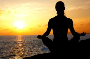 Lotus position on the edge of a cliff