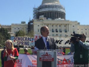 Dr. Lawrence Lessig speaks in front of the Capitol./Photo by John Zangas