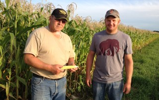 Harold Wilken (left) and Ross Wilken inspect their organic corn, August 2014. They helped open the doors to investment capital that promotes sustainable farming.
