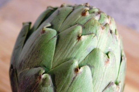Whole, raw artichoke