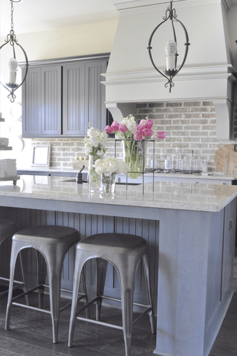 Kitchen with Aidan Gray Light Pendants Brick Backsplash