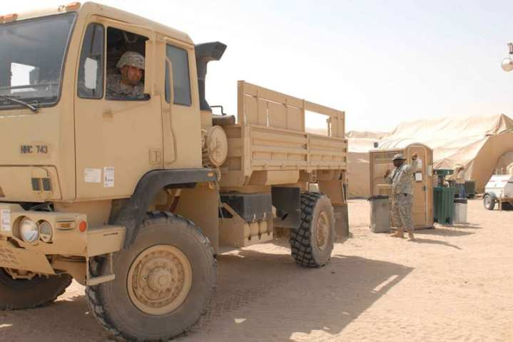 Staff Sgt. Vikramjit Kang, Third Army/U.S. Army Central Maintenance personnel, positions his FMTV truck near a power generator at Camp Buehring, Kuwait, May 29, 2009.   U.S. Army photo by Spc. Alex Godinez, Third Army/USARCENT Public Affairs