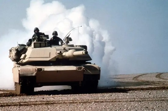 An M-1A1 Abrams main battle tank lays a smoke screen during maneuvers during Operation Desert Storm. DoD photo