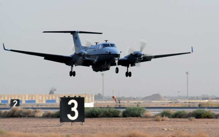 The first MC-12 Liberty aircraft in-theater lands after its first combat sortie at approximately 6:20 p.m. local time June 10, 2009,  at Joint Base Balad, Iraq. The Air Force's newest intelligence, surveillance and reconnaissance platform, the MC-12 is a medium-altitude manned special-mission turbo prop aircraft that supports coalition and joint ground forces. U.S. Air Force photo/Senior Airman Tiffany Trojca