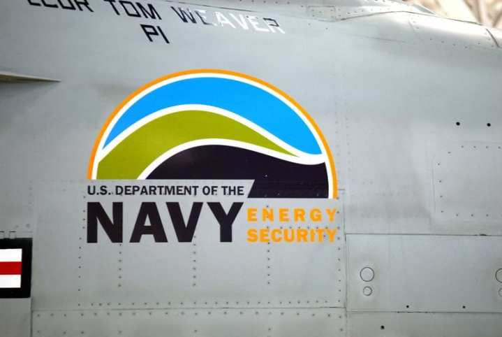 """The U.S. Department of the Navy Energy Security logo on the F/A-18 """"Green Hornet"""" from Air Test and Evaluation Squadron (VX) 23. VX-23 was testing the full envelope of the Super Hornet with a drop-in replacement biofuel made from the camelina plant in an effort to certify alternative fuels for naval aviation use. U.S. Navy photo by Mass Communication Specialist 2nd Class Clifford L. H. Davis."""