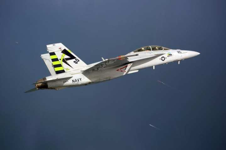 "An F/A-18F Super Hornet strike fighter, dubbed the ""Green Hornet,"" conducts a supersonic test flight. The aircraft is fueled with a 50/50 blend of biofuel and conventional fuel. The test, conducted at Naval Air Station Patuxent River, Md., drew hundreds of onlookers, including Secretary of the Navy Ray Mabus, who has made research, development, and increased use of alternative fuels a priority for the Department of the Navy. U.S. Navy photo by Liz Goettee."
