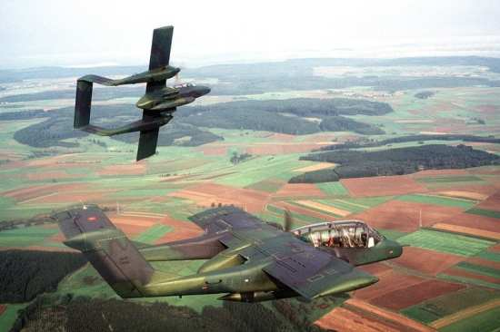 An air-to-air right side view of two OV-10 Bronco aircraft from the 601st Tactical Air Support Group, Sembach Air Base, Germany, during Exercise Reforger '81.
