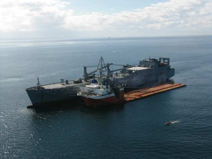The Military Sealift Command large, medium-speed, roll-on/roll-off ship USNS Watkins (background) and heavy lift ship MV Mighty Servant I moor side-by-side off San Diego during a Mobile Landing Platform demonstration Oct. 12, 2006. Cargo from Watkins was transferred to Mighty Servant I and then loaded onto hovercraft for delivery to shore during a test of the military logistics concept known as seabasing. Sea bases are envisioned as virtual floating military bases composed of more than a dozen amphibious assault ships, auxiliary vessels and connector vessels. These bases will enable the military to deploy U.S. forces and their cargo from the sea to contingency sites anywhere in the world. Photo courtesy of Navy Program Executive Office.