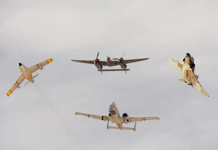An F-86 Sabre, P-38 Lightning, F-4 Phantom, and A-10 Thunderbolt (clockwise) break over Nellis Air Force Base, Nev., for the Air Combat Command heritage flight during the 2009 Aviation Nation open house Nov. 13, 2009. While AFMC is celebrating its 20th birthday as a command in 2012, its heritage and achievements go back to 1917. U.S. Air Force photo by Master Sgt. Kevin J. Gruenwald