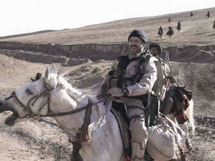 Then-Staff Sgt. Bart Decker, Air Force combat controller, on horseback with Northern Alliance forces. U.S. Army photo