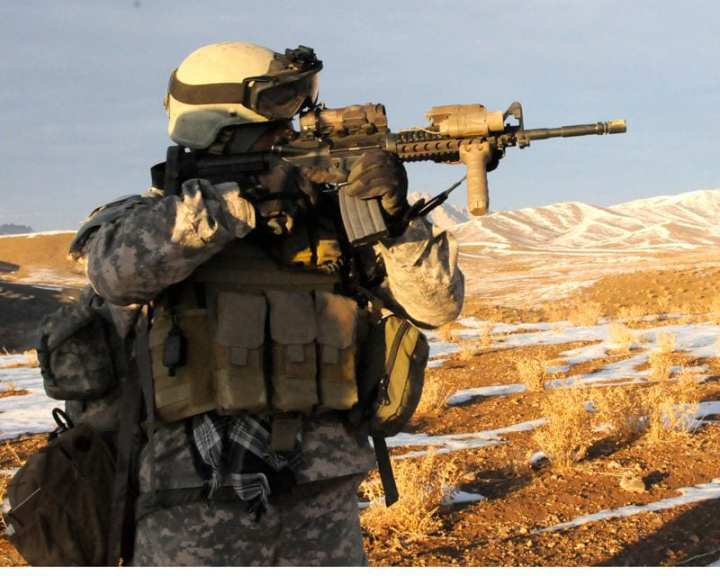 A Special Forces soldier provides security during a cordon and search of a suspected bomb-making facility at a remote village in the Arghandab District Dec. 10, 2009. U.S. Army photo