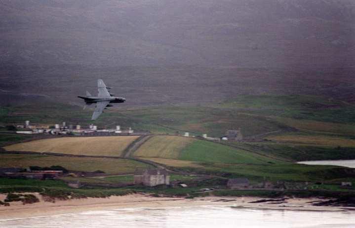 An A-7E Corsair II flies a low-level exercise