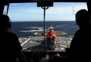 HH-65C Dolphin helicopter lands on the flight deck of the CGC Bertholf