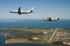 P-8 and P-3 over Pax