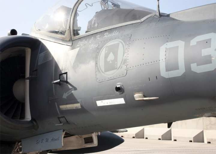 "A U.S. Marine Corps AV-8B Harrier sits on the flight line at Camp Bastion, Helmand province, Afghanistan Sept. 26, 2012. The Harrier was one of six relocated to Camp Bastion to increase the overall readiness level of Marine Attack Squadron (VMA) 211 and is painted in memory of Lt. Col. Christopher K. Raible and Sgt. Bradley W. Atwell, who were killed during an attack on Camp Bastion Sept. 14, 2012. The aircraft is still carrying markings from Marine squadron VMA-231 ""Ace of Spades,"" where most of the replacement aircraft were apparently drawn from. U.S. Marine Corps photo by Sgt. Keonaona Paulo"