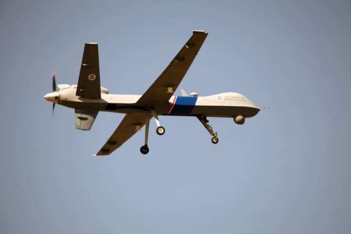 A remotely piloted Predator B UAS returns to Grand Forks Air Force Base, N.D. after flying in support of flood relief efforts in North Dakota and Minnesota, April 14, 2011. U.S. Customs and Border Protection photo by Kristoffer Grogan