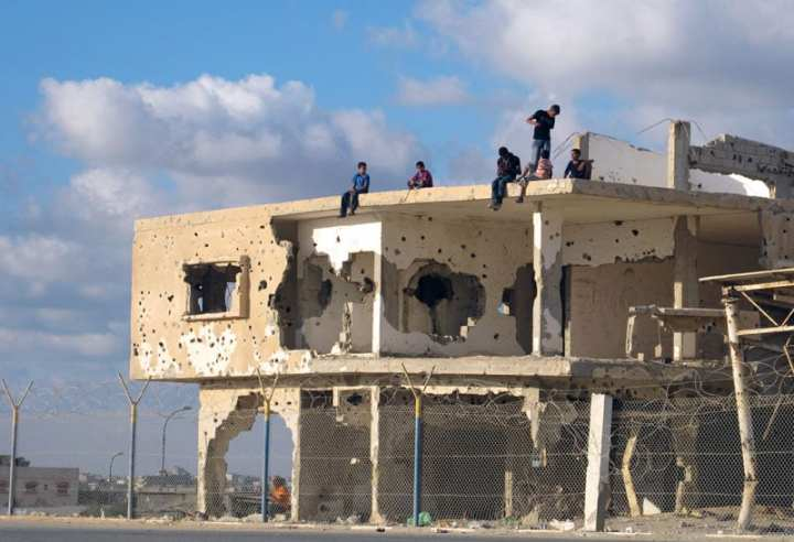 Children play atop a bullet-riddled building in Gaza. A resolution of the Israeli-Palestinian conflict would have a major impact on the world. U.N. photo by Shareef Sarhan