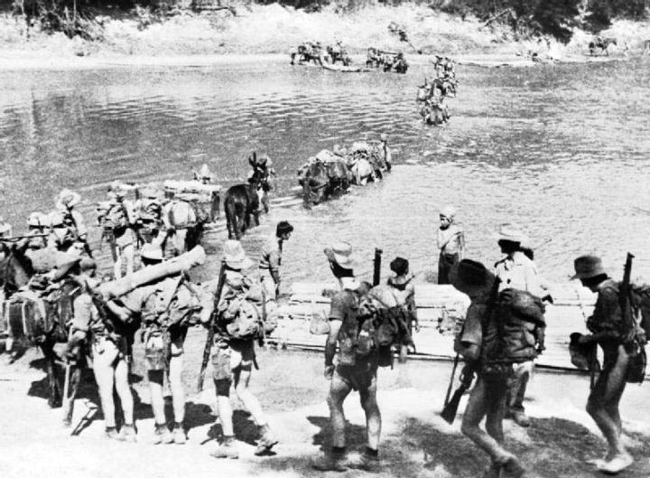 """Soldiers from the 77th Indian Infantry Division """"Chindits"""" cross the border of India to enter Burma in support of Operation Longcloth, Feb. 8, 1943. Imperial War Museum photo"""