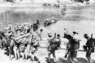 "Soldiers from the 77th Indian Infantry Division ""Chindits"" cross the border of India to enter Burma in support of Operation Longcloth, Feb. 8, 1943. Imperial War Museum photo"