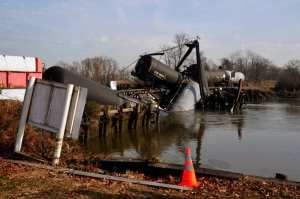 A train, reported to be carrying vinyl chloride, is derailed in Paulsboro, N.J., Nov. 30, 2012, after the railway bridge crossing Mantua Creek collapsed. The derailment prompted a multiagency emergency response. U.S. Coast Guard photo by Petty Officer 3rd Class Cindy Oldham