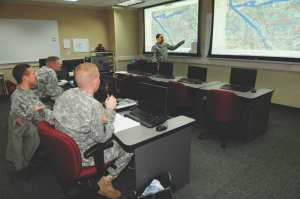 Chief Warrant Officer 3 Roy Stubbins, geospatial engineer course manager, instructs students Jan. 18, 2012, on aspects of geospatial engineering during the first week of the course at the U.S. Army Engineer School, based at Fort Leonard Wood, Mo. U.S. Army photo by Melissa K. Buckley