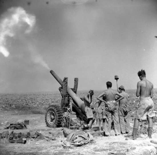 British army soldiers in action in Sicily during Operation Husky, July 23, 1943. The British advanced up the east coast of Sicily, while the Americans conducted a left hook up to Palermo. Imperial War Museum photo