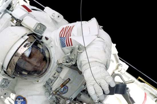 Former NASA Astronaut Ed Lu shown during an EVA on shuttle mission STS-106. NASA photo
