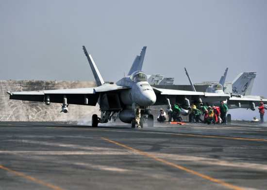 "A VFA-31 ""Tomcatters"" F/A-18E Super Hornet, armed with a Maverick missile, JDAM, and laser JDAMs, launches from the flight deck of the aircraft carrier USS George H.W. Bush (CVN 77) in late July. F/A-18s have escorted humanitarian airdrops and presumably carried out airstrikes against ISIL forces. U.S. Navy photo by Mass Communication Specialist 1st Class Joseph R. Vincent"