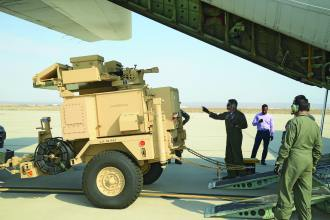 Two Sentinel radar systems are loaded onto a Chilean C-130 at Edwards Air Force Base (AFB) as part of a Foreign Military Sales case for Chile. Chile intends to use the radars to modernize its armed forces by expanding its existing air defense architecture to counter threats posed by air attack. The pick-up was crucial to ensure Chile received the systems to conduct scheduled training. The FMS case was a priority case for U.S. Southern Command and is expected to enhance greater interoperability between Chile and the United States, and among other allies. Edwards AFB personnel worked closely with personnel from the U.S. Army Security Assistance Command and the Chilean air force to coordinate the flight and loading. U.S. Air Force photo by Kenji Thulowei