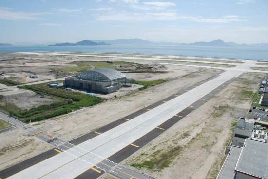 The new runway at Marine Corps Air Station Iwakuni extends the previous runway 1 kilometer (1,093 yards) and was constructed for safety-related issues, as well as reducing noise over Iwakuni. The project began in 1997 and was completed by the U.S. Army Corps of Engineers Japan District in spring 2010. U.S. Army Corps of Engineers Japan District photo