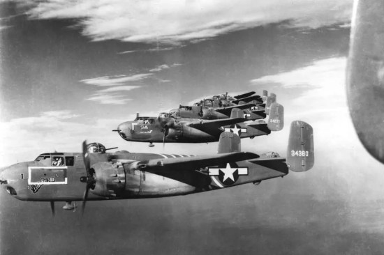 The first special operations gunships might arguably be these B-25H Mitchells of the 1st Air Commando Group, armed with .50-caliber machine guns, 75 mm cannon, and bombs. U.S. Air Force photo