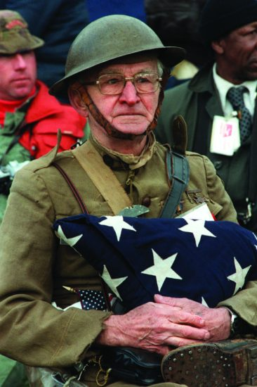 Joseph Ambrose, an 86-year-old World War I veteran, attends the dedication day parade for the Vietnam Veterans Memorial in 1982. He is holding the flag that covered the casket of his son, who was killed in the Korean War. ArmsticeDay, established to honor those like Ambrose who fought in World War I, became Veterans Day in 1954, honoring all those who have served. Mickey Sanborn