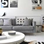 una villa de lujo en suecia sillas easmes sillas eames sillas de diseño rústico moderneo rustico minimalista paredes de cemento muebles de diseño madera estilo nórdico estilo escandinavo espacios diáfanos diseño nórdico decoración en gris decoración de interiores cocina de diseño casa de campo sueca blanco y negro
