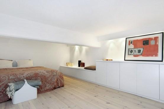 silla butterfly eames muebles de diseño Luminoso loft sueco con vistas lámparas de diseño estilo nórdico escandinavo encimera revestimiento marmol de carrara decoración nordica loft dec