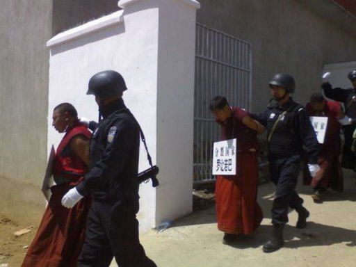 China Police w Detained Monks Shamed