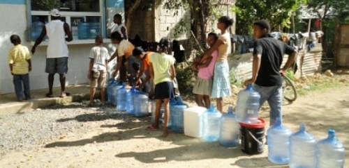 Misc Africans Line up For Water With Jugs