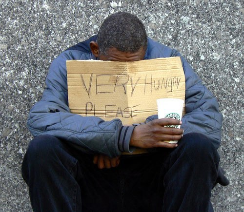 Homeless Man w Sign Very Hungry