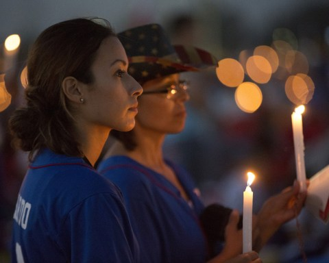 World Youth Day pilgrims hold candles during eucharistic adoration with Pope Francis at the July 30 prayer vigil at the Field of Mercy in Krakow, Poland. (CNS photo/Jaclyn Lippelmann, Catholic Standard) See POPE-POLAND-WYD-VIGIL July 30, 2016.