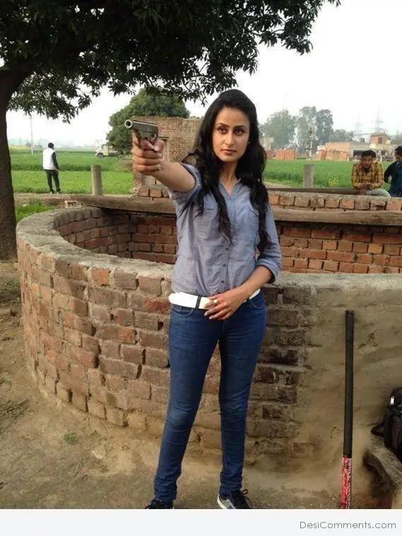 Punjabi Girl With Gun Hd Wallpaper Jaspinder Cheema Holding Gun Desicomments Com