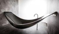 a hammock-shaped carbon fibre bathtub by splinter works